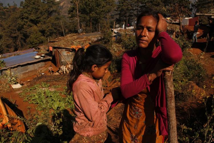 Saraswati Chuhan with her daughter near their temporary shelter in Sailibhanjyang village in Sindhupalchowk. Photo: Bhrikuti Rai